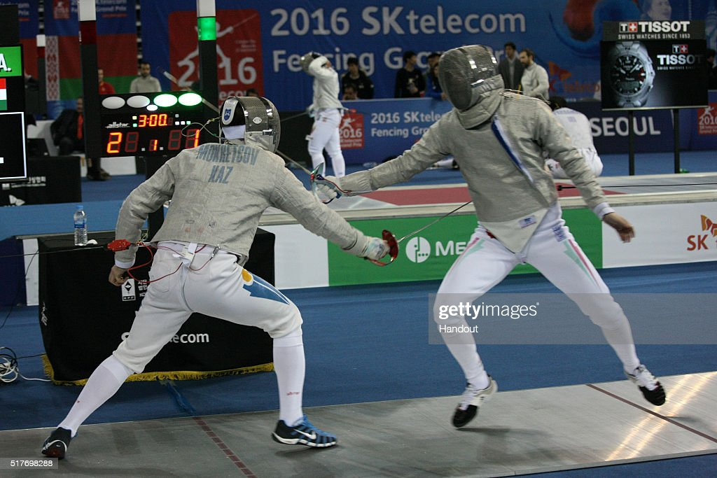 In this handout image provided by the FIE, Ilya Mokretcov of Kazakhstan and Andras Szatmari of Hungary compete during the individual Men's Sabre match during day 1 of the FIE Grand Prix on March 25, 2016 in Seoul, South Korea.