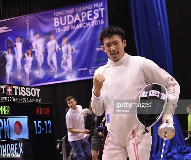 In this handout image provided by the FIE Kazuyasu Minobe of Japan competes during the individual men's epee match and qualifies for the Rio Olympic...