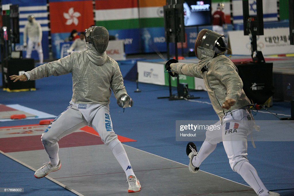 In this handout image provided by the FIE, Luca Curatoli of Italy and Maxence Lambert of France compete during the individual Men's Sabre match during day 1 of the FIE Grand Prix on March 25, 2016 in Seoul, South Korea.