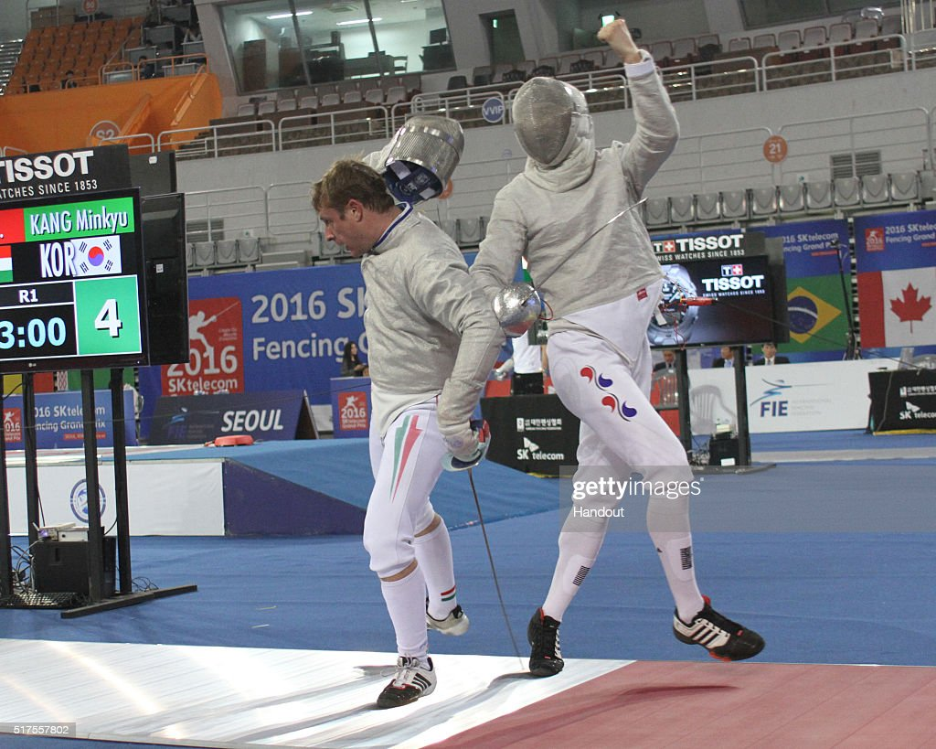 In this handout image provided by the FIE, Nikolas Iliasz of Hungary and Kang Minkyu of Korea compete during the individual Men's Sabre match during day 1 of the FIE Grand Prix on March 25, 2016 in Seoul, South Korea.