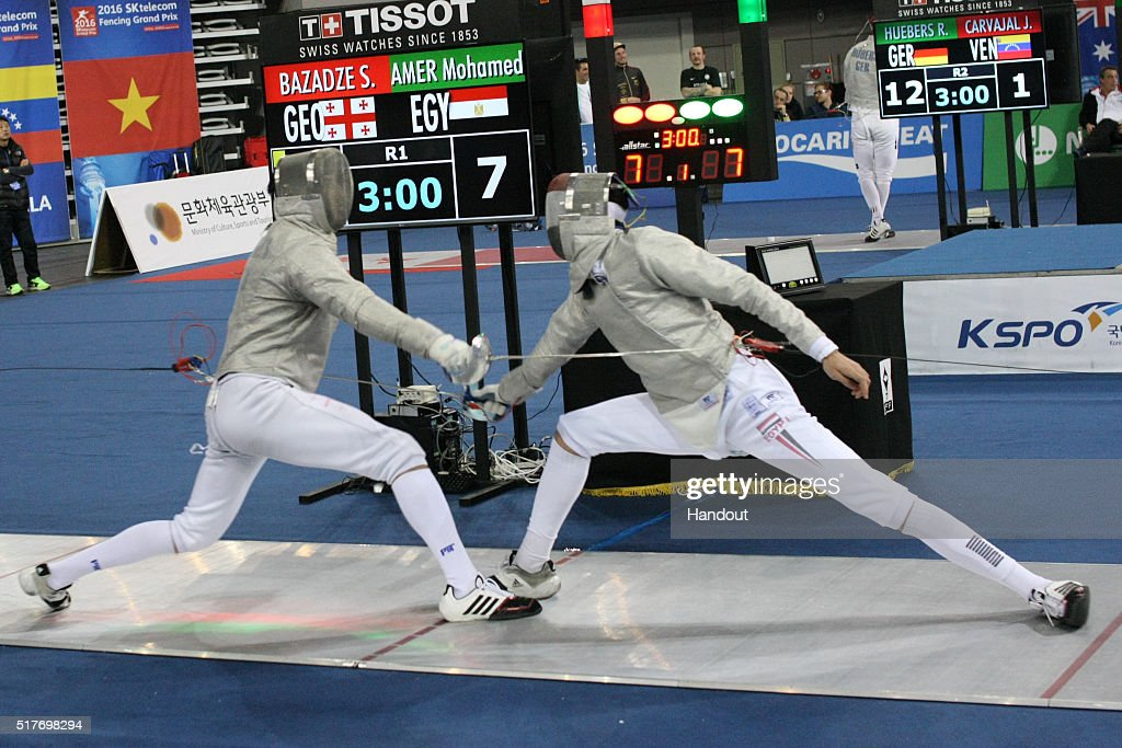 In this handout image provided by the FIE, Sandro Bazadze of Georgia and Amer Mohamed of Egypt compete during the individual Men's Sabre match during day 1 of the FIE Grand Prix on March 25, 2016 in Seoul, South Korea.