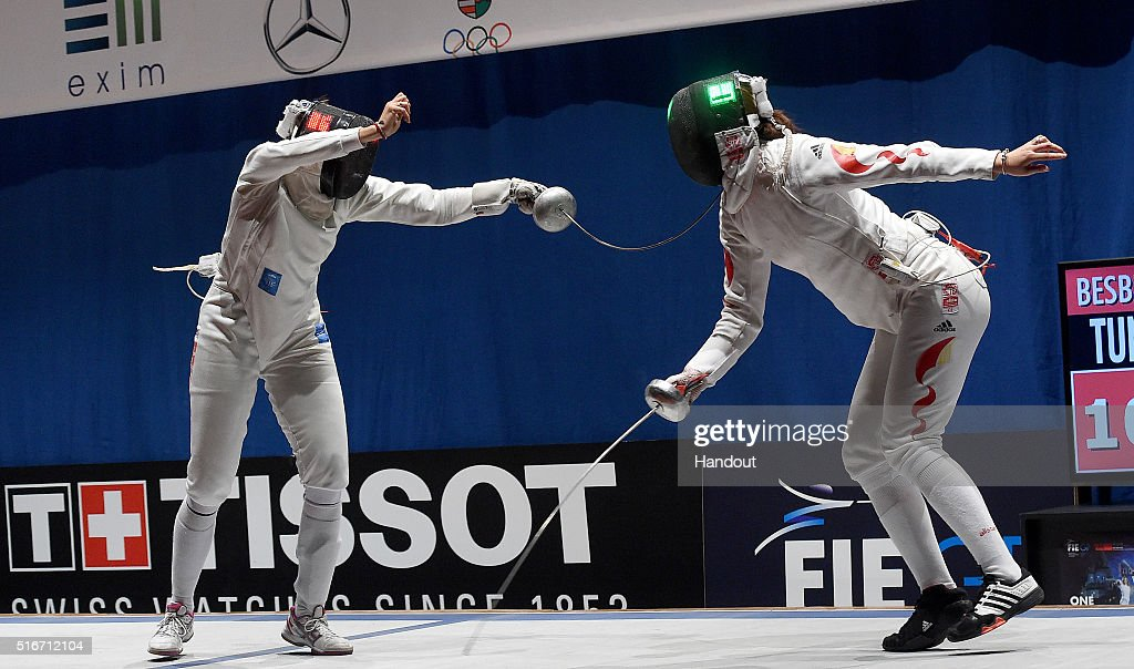 In this handout image provided by the FIE, Sarra Besbes of Tunisia and Xu Anqi of China compete during the individual women's epee match on day 3 of the WESTEND Grand Prix on March 20, 2016 in Budapest, Hungary.