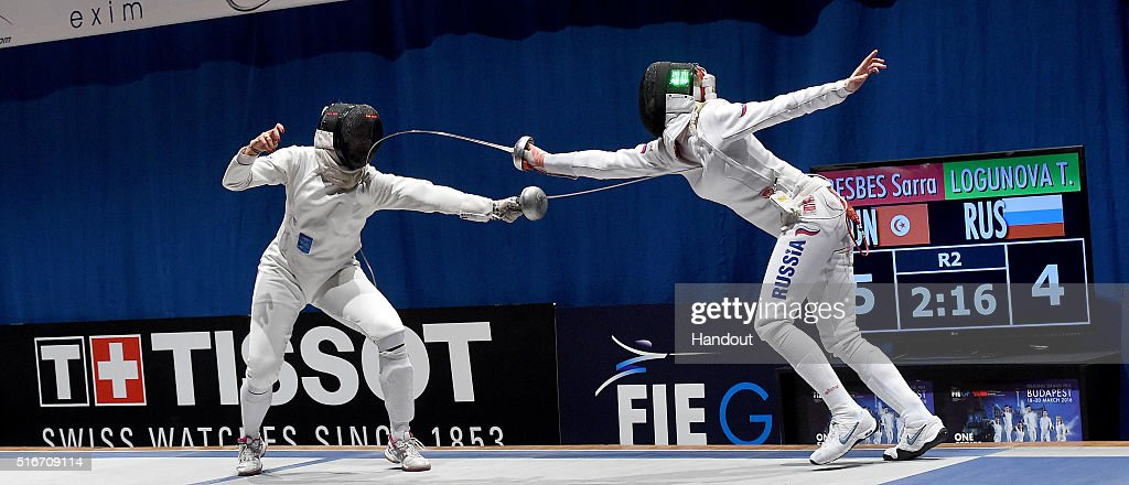 In this handout image provided by the FIE, Tatiana Logunova of Russia and Sarra Besbes of Tunisian competes during the individual women's epee match during day 3 of the WESTEND Grand Prix on March 20, 2016 in Budapest, Hungary.
