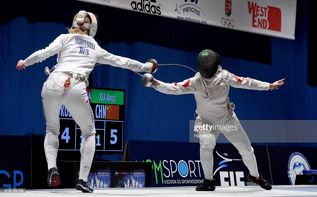 In this handout image provided by the FIE, Tatyana Andryushina is a Russian and Xu Anqi of China compete during the individual women's epee match during day 3 of the WESTEND Grand Prix on March 20, 2016 in Budapest, Hungary.