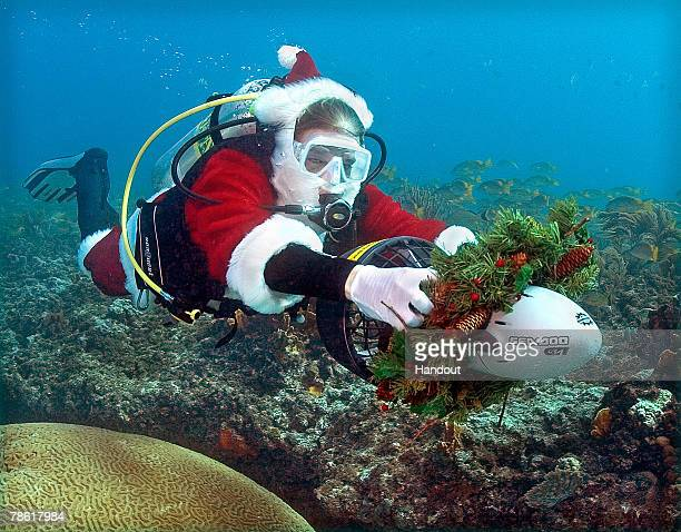 In this handout image provided by the Florida Keys News Bureau Jason Schwenke is towed by a Christmas wreathdecorated sea scooter in the Florida Keys...