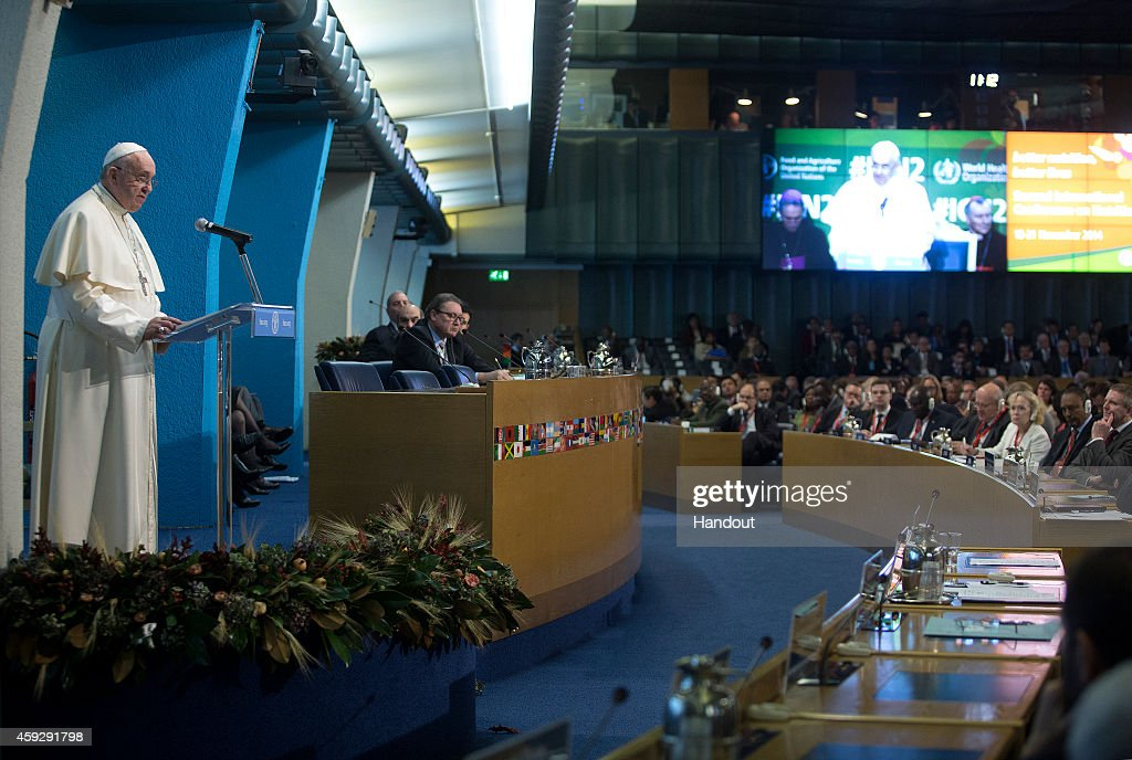 In this handout image provided by the Food and Agriculture Organization of the UN (FAO), Pope Francis speaks during the Second International Conference on Nutrition in the Plenary Hall at the Fao Headquarters on November 20, 2014 in Rome, Italy. In his address to participants the Holy Father spoke of waste and excessive consumption of food.