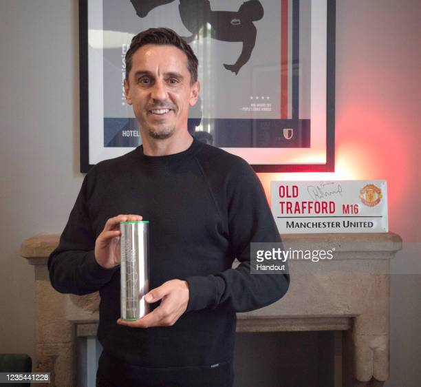 In this handout image provided by the Football Business Awards, Gary Neville poses with his Global Football Ambassador Award, 2021.