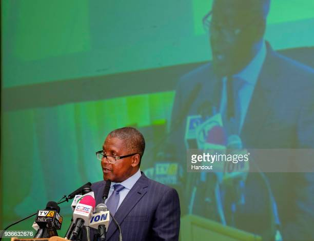 In this handout image provided by the Gates Archive Alhaji Aliko Dangote President CEO Dangote Group speaks to the National Economic Council at the...