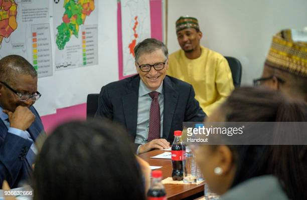 In this handout image provided by the Gates Archive Bill Gates Cochair and Trustee Bill Melinda Gates Foundation middle and Alhaji Aliko Dangote...