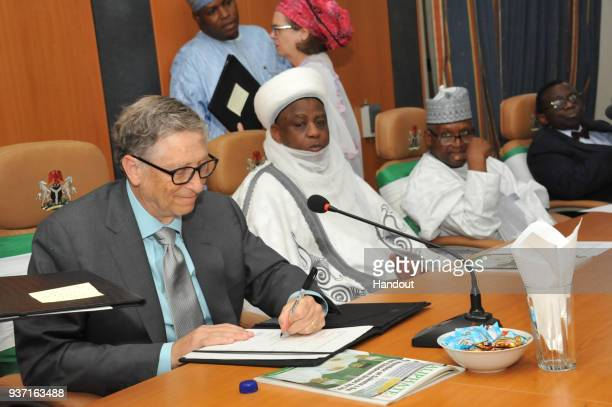 In this handout image provided by the Gates Archive Bill Gates CoChair and Trustee Bill Melinda Gates Foundation signs a Routine Immunization...
