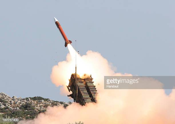 In this handout image provided by the German Bundeswehr armed forces a patriot missile is fired during the Operation Red Arrow exercise on October 15...