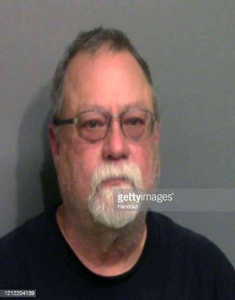 In this handout image provided by the Glynn County Sheriff's Office Gregory McMichael poses for a mugshot photo after being arrested in connection...