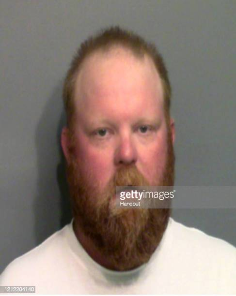 In this handout image provided by the Glynn County Sheriff's Office, Travis McMichael poses for a mugshot photo after being arrested in connection...