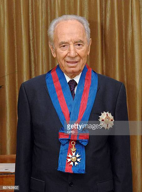In this handout image provided by the GPO Israeli President Shimon Peres wears the honourary Knight Commander's Order of St Michael and St George...