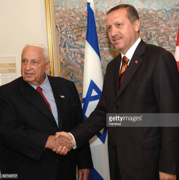 In this handout image provided by the GPO, Israeli Prime Minister Ariel Sharon shakes hands with his Turkish counterpart, Recep Tayyip Erdogan, prior...