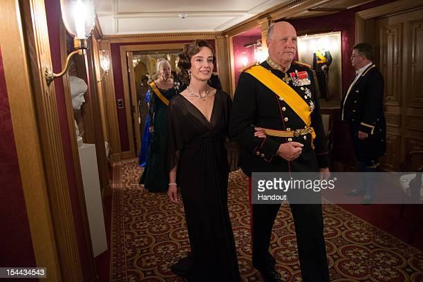 In this handout image provided by the GrandDucal Court of Luxembourg Mrs John Hamilton and King Harald V of Norway attend a Gala dinner for the...