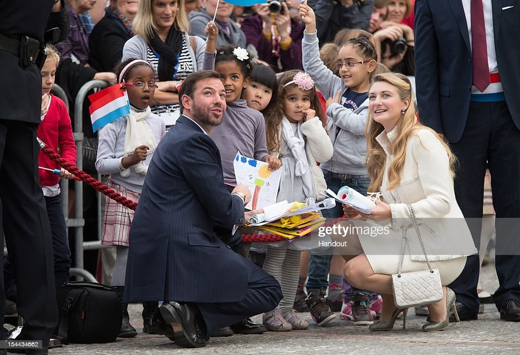 In this handout image provided by the Grand-Ducal Court of Luxembourg, Prince Guillaume of Luxembourg and Countess Stephanie de Lannoy talk with children as they attend their wedding civil ceremony at the Hotel De Ville on October 19, 2012 in Luxembourg, Luxembourg. The 30-year old hereditary Grand Duke of Luxembourg is the last hereditary Prince in Europe to get married, marrying his 28-year old Belgian Countess bride in a lavish 2-day ceremony.