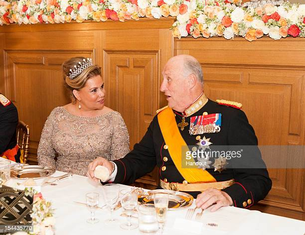 In this handout image provided by the GrandDucal Court of Luxembourg Duchess Maria Teresa of Luxembourg and King Harald V of Norway attend a Gala...