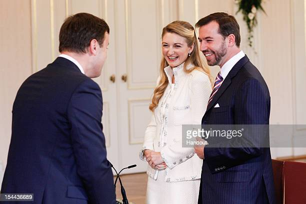 In this handout image provided by the Grand-Ducal Court of Luxembourg, Mayor of Luxembourg Xavier Bettel speaks with Prince Guillaume of Luxembourg...