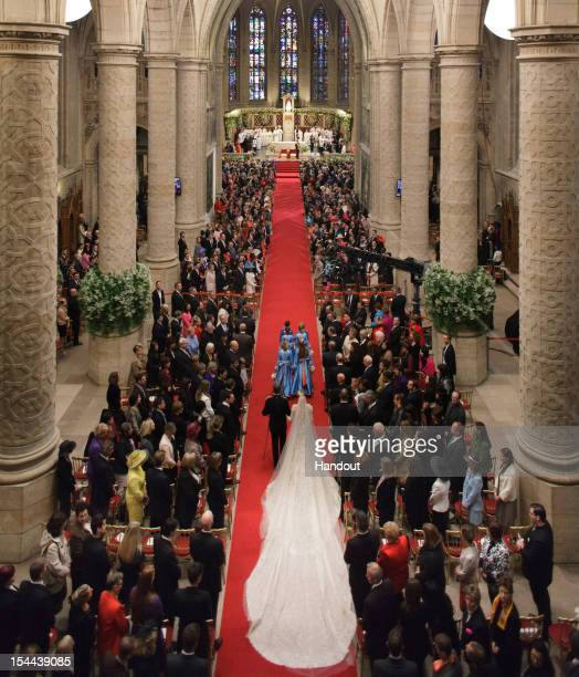 In this handout image provided by the Grand-Ducal Court of Luxembourg, Princess Stephanie of Luxembourg walks down the aisle with her brother Count...