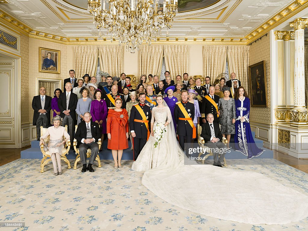 In this handout image provided by the Grand-Ducal Court of Luxembourg, Princess Stephanie of Luxembourg and Prince Guillaume of Luxembourg pose with Royals Luxembourg, Grand-Duke, H.M. Queen Fabiola, H.R.H.Grand-Duke Jean /Grand-Duchess Maria Teresa, Crown Grand-Duchess of Luxembourg, H.R.H Grand-Duke Henri, The Count de Lannoy, 2nd row - left to right : H.S.H. Reigning Prince of Liechtenstein, H.S.H Reigning Princess of Liechtenstein, H.M. Queen of Sweden, H.M. King of Norway, H.M. Queen of Norway, H.R.H. Prince Consort, H.M. Queen of Denmark, H.M. Queen of the Netherlands, H.M. King of Belgians, H.M. Queen of Belgians, H.R.H. Princess Lalla Salma of Morocco, 3rd row - left to right : H.R.H Prince Hassan of Jordan, H.R.H. Princess Sarvath of Jordan, H.R.H. Princess of the Asturias, H.R.H. Prince of the Asturias, H.R.H. Crown Prince of Japan, H.R.H. the Countess of Wessex, H.R.H. Princess of Hanover, H.R.H Prince of Orange of the Netherlands, H.R.H. Princess Maxima of the Netherlands, 4th row - left to right : H.M. Queen Anne-Marie of the Hellenes, H.M. King Constantin of the Hellenes, H.R.H Crown Princess of Denmark, H.R.H Crown Prince of Denmark, H.R.H Duchess of Brabant, H.R.H Duke of Brabant, H.R.H Crown Princess of Norway, H.R.H Crown Prince of Norway, H.R.H Crown Princess of Sweden, H.R.H Prince Daniel of Sweden, H.E. Sheikh Nahyan Bin Mubarak Al Nahyan, 5th row - left to right :H.R.H Prince Radu of Romania, H.R.H Crown Princess of Romania, Princess Tessy, H.R.H. Prince Louis, H.R.H. Princess Alexandra, H.R.H. Prince Felix, H.R.H. Prince Sebastien, H.M. Queen Margarita of the Bulgarian, H.M. Simeon II of the Bulgarian for an official photo in of the Grand-Ducal Palace after their wedding ceremony at the Cathedral of our Lady of Luxembourg on October 20, 2012 in Luxembourg, Luxembourg.