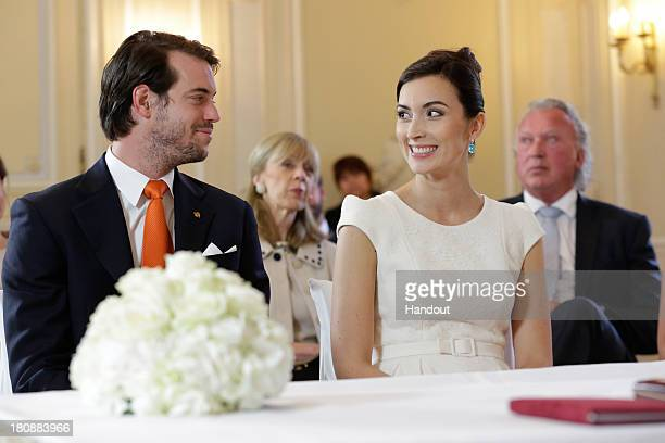 In this handout image provided by the GrandDucal Court of Luxembourg Prince Felix Of Luxembourg and Claire Lademacher attend their Civil Wedding at...