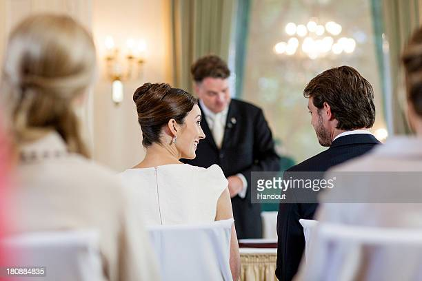 In this handout image provided by the GrandDucal Court of Luxembourg Claire Lademacher and Prince Felix Of Luxembourg exchange a look as they attend...