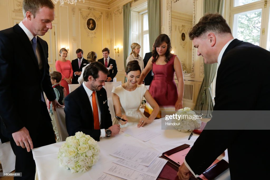 In this handout image provided by the Grand-Ducal Court of Luxembourg, Prince Felix Of Luxembourg and Claire Lademacher sign their civil wedding contract in front of witnessses, Felix Lademacher, Princess Alexandra, Mayor Leonhard Helm and their respective family as they celebrates their Civil Wedding at Villa Rothschild Kempinski on September 17, 2013 in Konigstein, Germany. ©Grand-Ducal Court/Guy Wolff. All rights reserved.