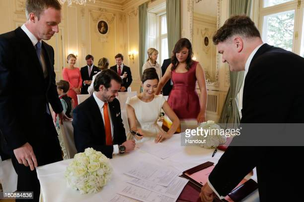 In this handout image provided by the GrandDucal Court of Luxembourg Prince Felix Of Luxembourg and Claire Lademacher sign their civil wedding...