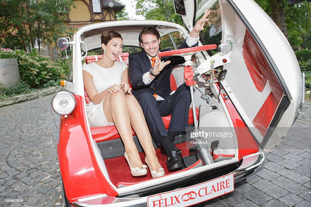 In this handout image provided by the Grand-Ducal Court of Luxembourg, Prince Felix Of Luxembourg and Princess Claire of Luxembourg depart in the Italian-designed BMW Isetta 300 microcar after their Civil Wedding Ceremony at Villa Rothschild Kempinski on September 17, 2013 in Konigstein, Germany. ©Grand-Ducal Court/Eric Chenal. All rights reserved.