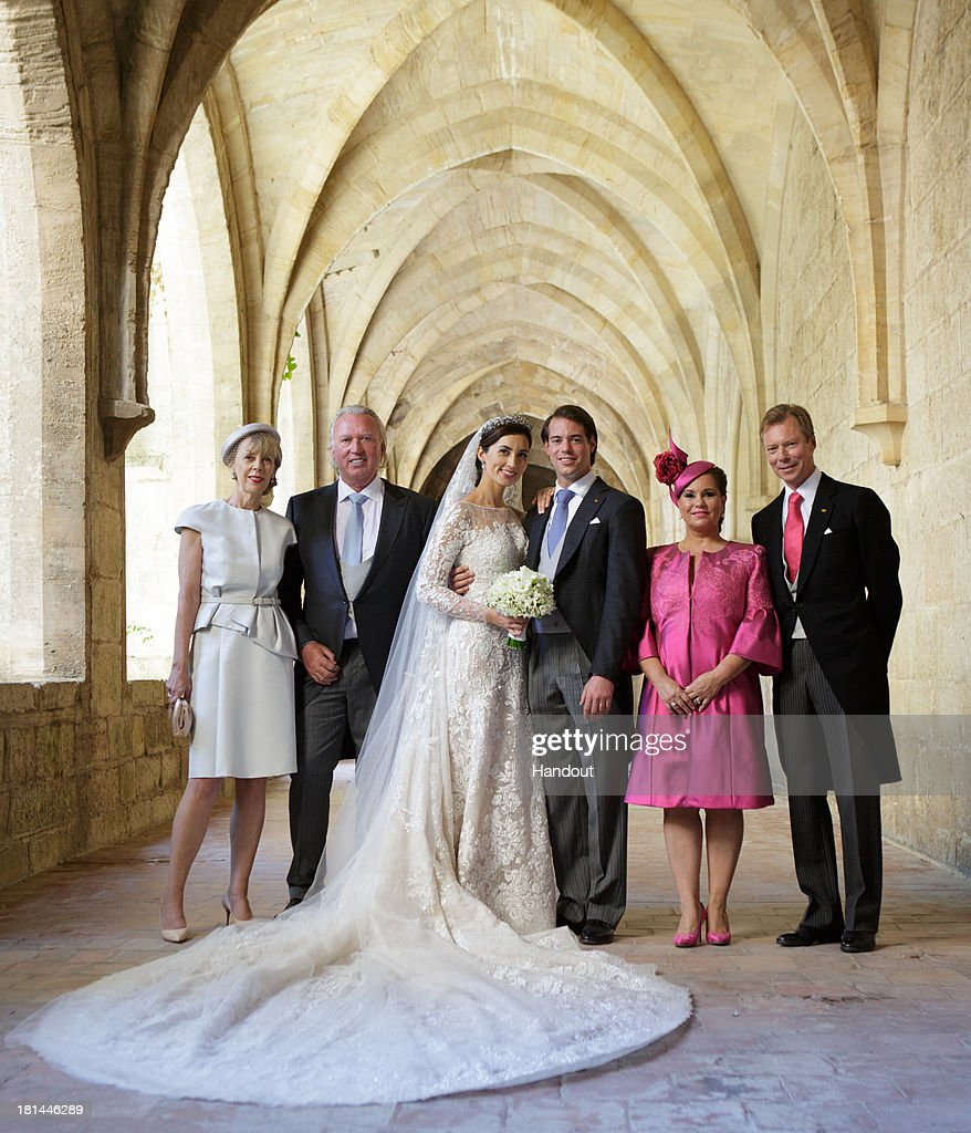 In this handout image provided by the Grand-Ducal Court of Luxembourg, Prince Felix Of Luxembourg and Princess Claire Of Luxembourg pose with Gabriele Lademacher, Hartmut Lademacher, Grand Duchess Maria Teresa and Grand Duke Henri for an official photo inside the Couvent Royal De Saint-Maximin after their wedding ceremony at the Basilique Sainte Marie-Madeleine on September 21, 2013 in Saint-Maximin-La-Sainte-Baume, France. ©Grand-Ducal Court/Guy Wolff/All rights reserved.