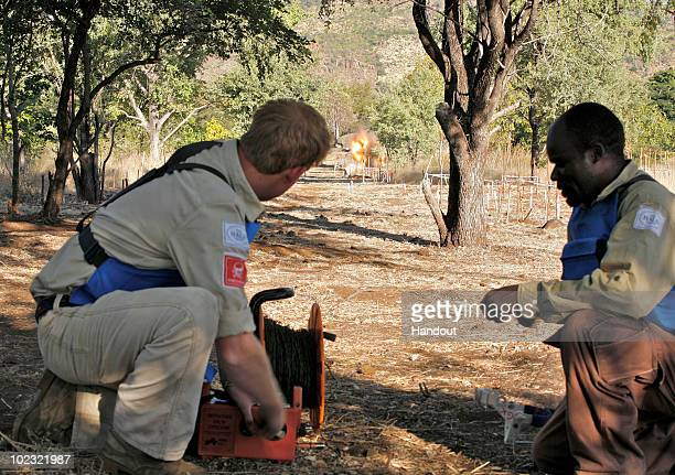 In this handout image provided by The HALO Trust, Prince Harry is seen with a deminer from The HALO Trust, a British charity dedicated to removal of...