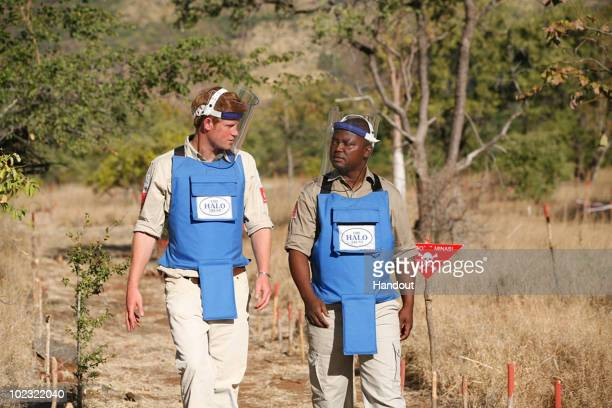 In this handout image provided by The HALO Trust Prince Harry is seen with a deminer from The HALO Trust a British charity dedicated to removal of...