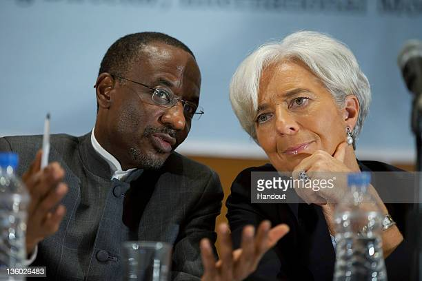 In this handout image provided by the International Monetary Fund talks with Nigerian Central Bank Governor Sanusi Lamido Sanusi during a joint press...