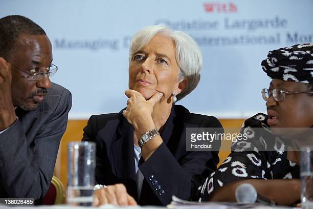 In this handout image provided by the International Monetary Fund International Monetary Fund's Managing Director Christine Lagarde sits between...