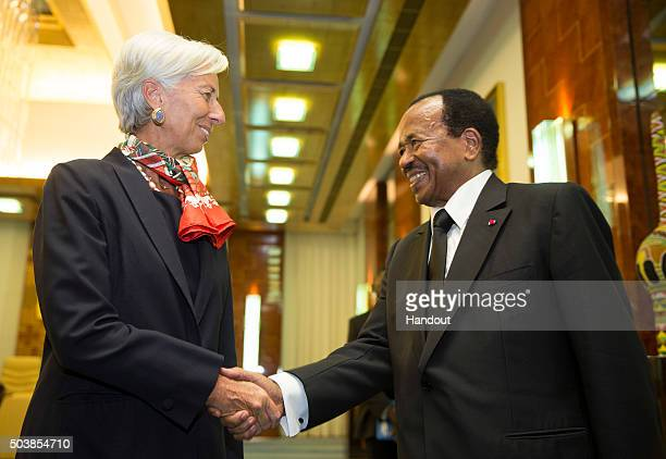 In this handout image provided by the International Monetary Fund International Monetary Fund Managing Director Christine Lagarde shakes hands with...
