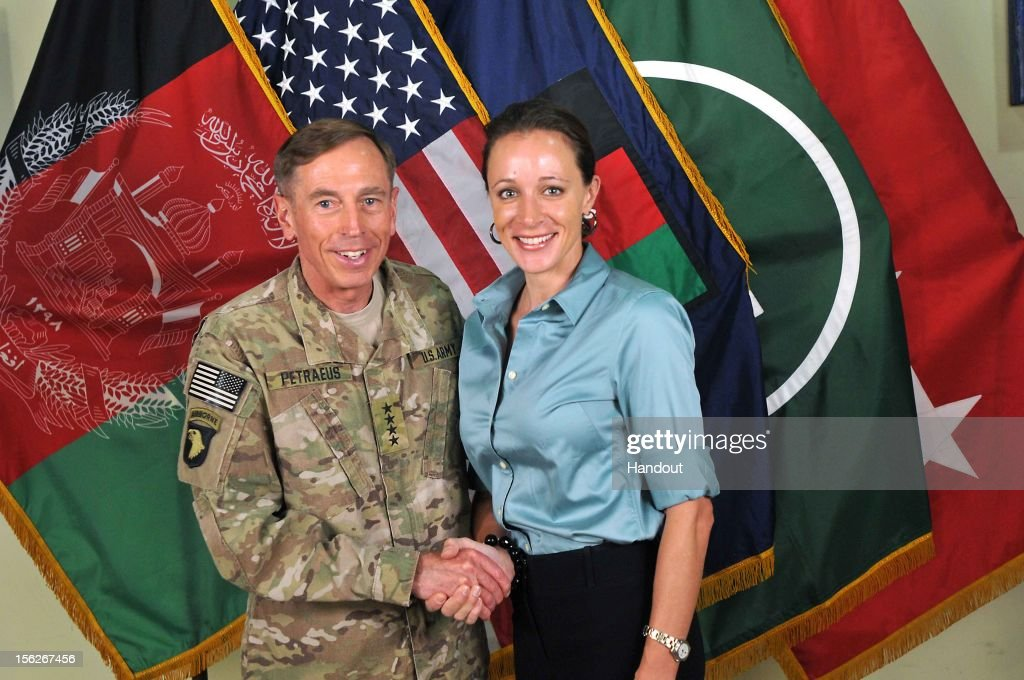 In this handout image provided by the International Security Assistance Force (ISAF), former Commander of International Security Assistance Force and U.S. Forces-Afghanistan; CIA Director Gen. Davis Petraeus (L) shakes hands with biographer Paula Broadwell, co-author of 'All In: The Education of General David Petraeus' on July 13, 2011. CIA Director Gen. David Petraeus resigned from his post on November 9, 2012, citing an extra-marital affair with Paula Broadwell. The FBI began an investigation after it was tipped off by Jill Kelley, a long-time friend of the Petraeus family, who received threatening emails from Broadwell.