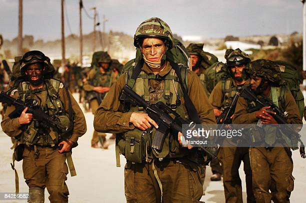 In this handout image provided by the Israeli Defense Forces , Israeli reserve forces enter the Gaza Strip January 12, 2009 in the Gaza Strip....