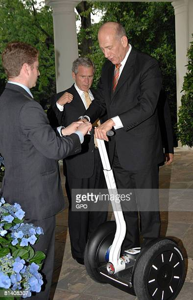 In this handout image provided by the Israeli Goverment Press Office , Israeli Prime Minister Ehud Olmert tries a Segway he received from U.S....