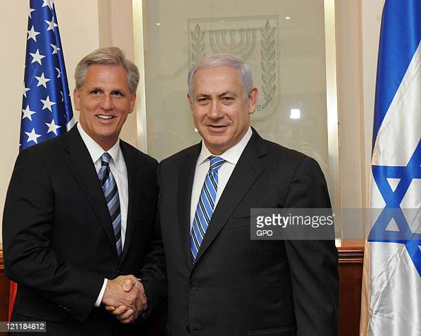 In this handout image provided by the Israeli Government Press Office Israeli Prime Minister Benjamin Netanyahu shakes hands with US Congressman...