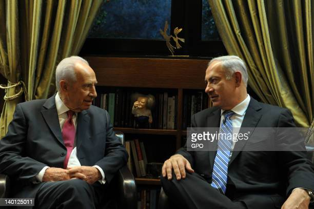 In this handout image provided by the Israeli Government Press Office , Israeli President Shimon Peres and Israeli Prime Minister Benyamin Netanyahu...