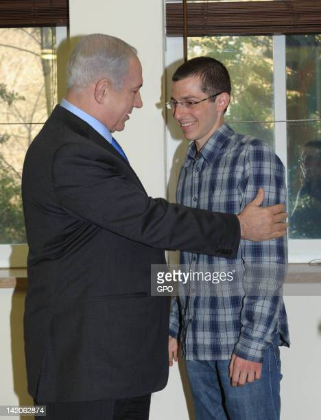 In this handout image provided by the Israeli Government Press Office Israeli Prime Minister Benjamin Netanyahu meets with Gilad Shalit five months...