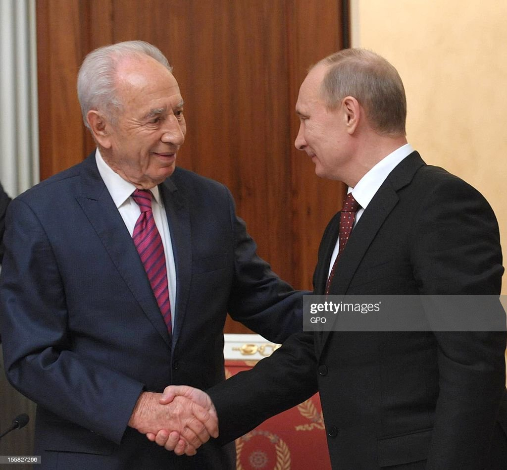 In this handout image provided by the Israeli Government Press Office (GPO), Russia's President Vladimir Putin (R) shakes hands with his Israeli counterpart Shimon Peres during a joint press conference at the Kremlin on November 8, 2012 in Moscow, Russia.