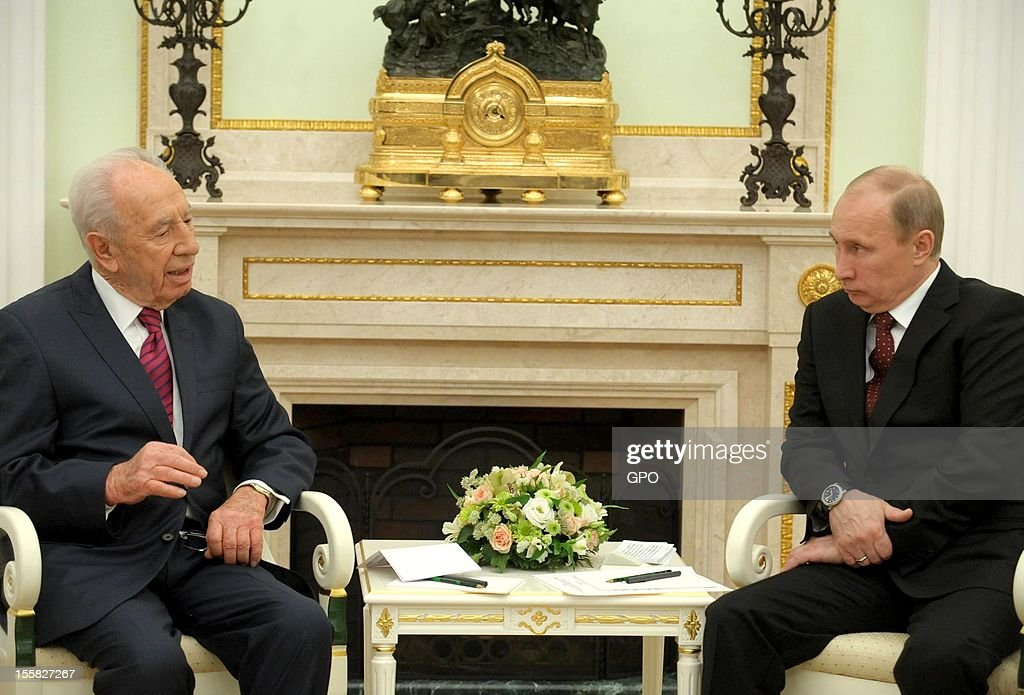In this handout image provided by the Israeli Government Press Office (GPO), Russia's President Vladimir Putin (R) and his Israeli counterpart Shimon Peres attend a meeting at the Kremlin on November 8, 2012 in Moscow, Russia.