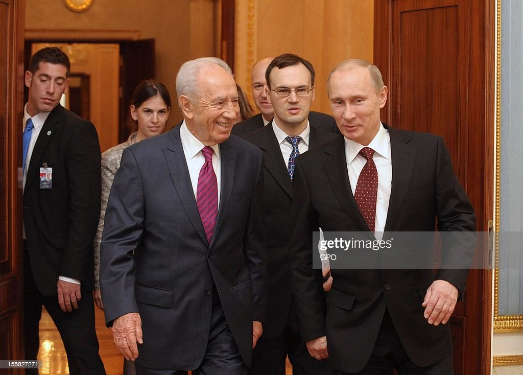 In this handout image provided by the Israeli Government Press Office (GPO), Russia's President Vladimir Putin (R) and his Israeli counterpart Shimon Peres arrive at a joint press conference at the Kremlin on November 8, 2012 in Moscow, Russia.