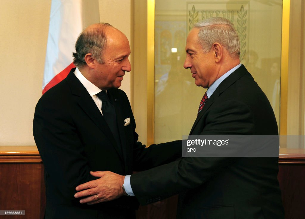 In this handout image provided by the Israeli Government Press Office (GPO), Prime Minister Benjamin Netanyahu (R) meets with French Foreign Minister Laurent Fabius at the Prime Minister's offices on November 18, 2012 in Jerusalem. Israel. Israeli shelling of Gaza has entered its fifth day, with two media buildings being recently struck and several journalists injured. According to health officials in Gaza, at least 50 Palestinians have been killed since Israel launched operation Pillar of Defence. So far three Israelis have died in the exchange of missiles which followed an air strike on Wednesday that killed Hamas military chief Ahmed Jabari.