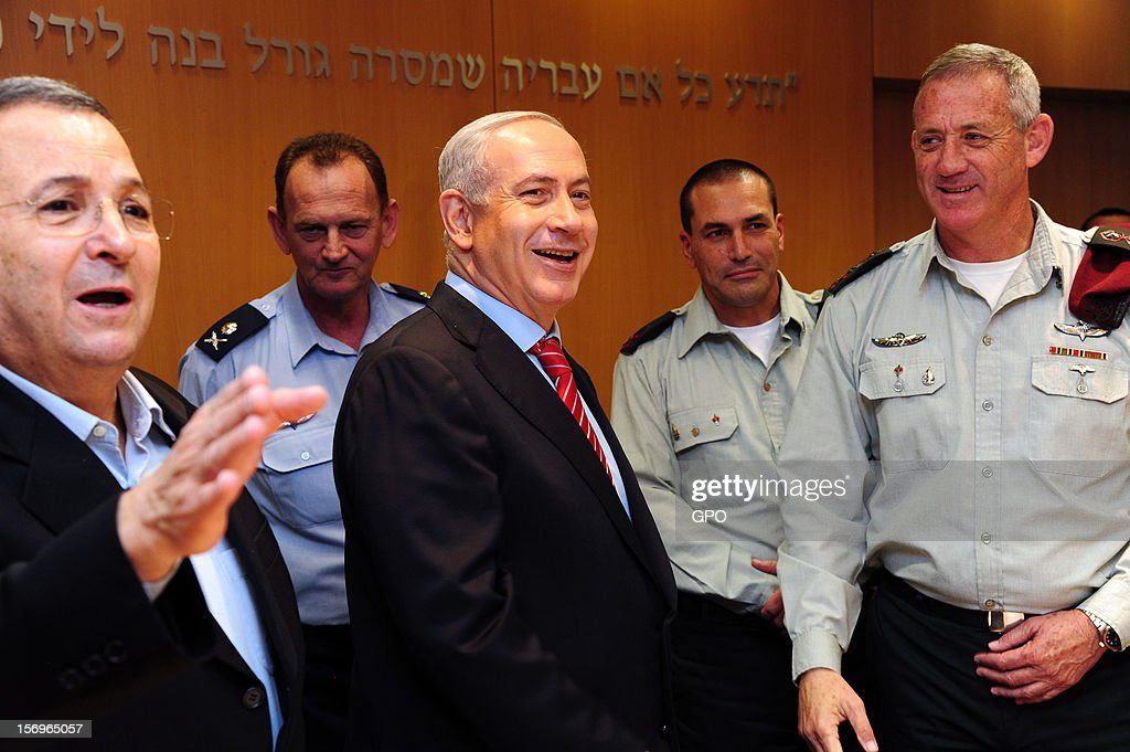 In this handout image provided by the Israeli Government Press Office (GPO), Prime Minister Benjamin Netanyahu (C), Defence Minister Ehud Barak (L), outgoing military secretary Yohanan Locker (2nd L), Brig. Gen. Eyal Zamir (2nd R), the new military secretary, and IDF Chief of Staff Lt.-Gen. Benny Gantz (R) look on November 26, 2012 in Tel Aviv, Israel. The appointment comes following eight days of conflict with Hamas.
