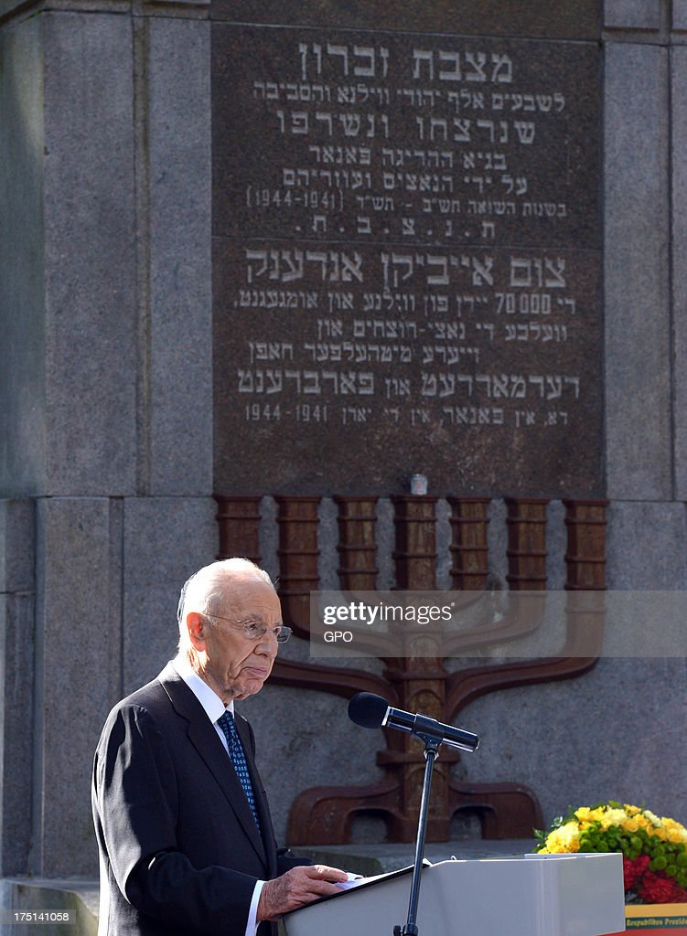 In this handout image provided by the Israeli Government Press Office (GPO), Israeli President Shimon Peres speaks during a remembrance ceremony at Paneriai Memorial on August 01, 2013 in Paneriai near Vilnius, Lithuania. Israel's president Shimon Peres and Lithuania's President Dalia Grybauskaite attended a ceremony of remembrance for around 100,000 victims, over half of whom were Jewish, of the massacre that took place at the site by Nazis and a group of Lithuanians from organisations such as the Vilnius Special Squad between July 1941 and August 1944 during World War II.