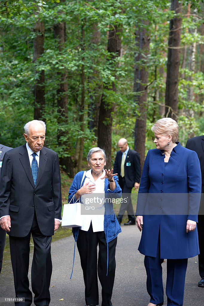 In this handout image provided by the Israeli Government Press Office (GPO), Israeli President Shimon Peres (L) and Lithuania's President Dalia Grybauskaite (R) attend a remembrance ceremony at Paneriai Memorial on August 01, 2013 in Paneriai near Vilnius, Lithuania. Israel's president Shimon Peres and Lithuania's President Dalia Grybauskaite attended a ceremony of remembrance for around 100,000 victims, over half of whom were Jewish, who were murdered at the site by German Nazis and Lithuanian groups from organisations such as the Vilnius Special Squad between July 1941 and August 1944 during World War II.
