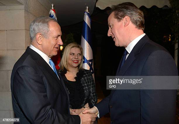 In this handout image provided by the Israeli Government Press Office British Prime Minister David Cameron speaks with Israeli Prime Minister...